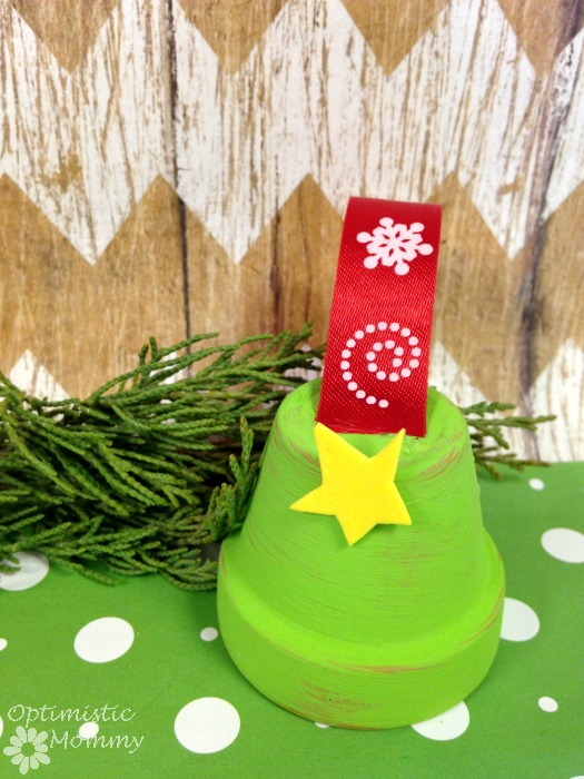 Flower Pot Christmas Tree Ornament: Do you love making your own holiday ornaments?  Then take a peek below at how you can turn an ordinary flower pot into a tiny tree perfect for hanging.  You only need a few supplies, and this is a craft perfect for children or adults to enjoy. | Optimistic Mommy