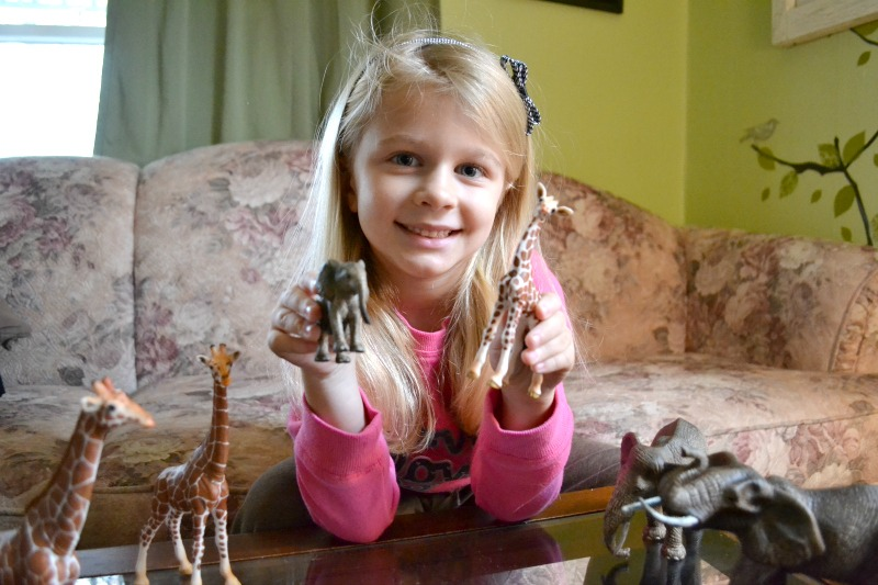 Riley With Schleich African Elephants and Giraffes