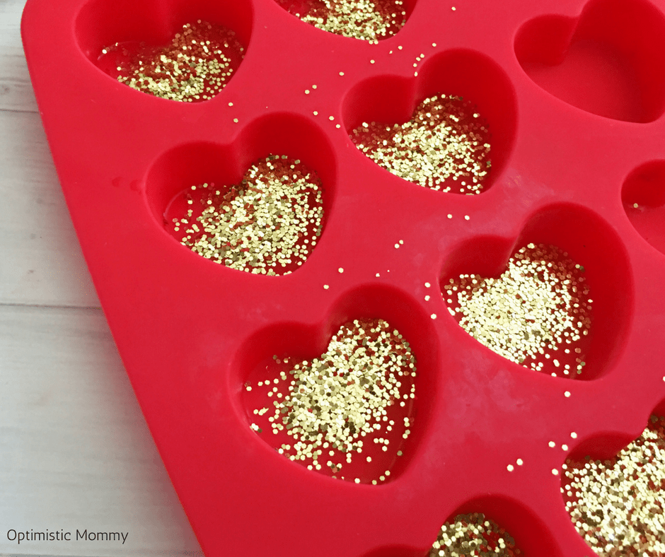 Make our DIY Valentine Hearts Glitter Crayons as a fun and easy craft kids will love helping you make to give to their friends this year! Valentine Craft ideas like this are perfect for little ones!