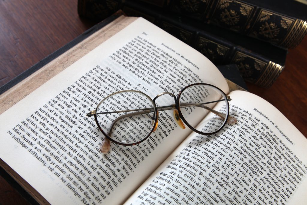 Glasses on an antique book