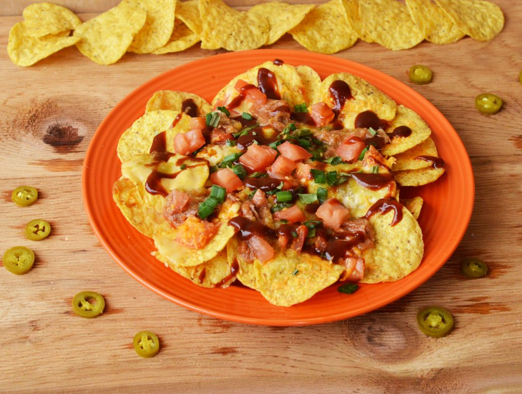 Enjoy game day even more when you make these delicious Game Day Pulled Pork Nachos using Curly's BBQ Pulled Pork!