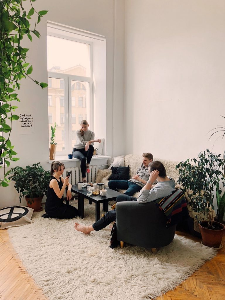 friends and family sitting in living room