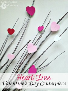 Heart Tree Valentine's Day Centerpiece: Wouldn't it be lovely if Valentine's grew on trees? This Valentine's Day, grow your own tree of love when you craft this Heart Tree Valentine's Day centerpiece. Made from less than $5 worth of supplies, you can craft a tree just as you see here. It is perfect for displaying in a vase on your Valentine's Day table, or even for giving as a gift. | Optimistic Mommy