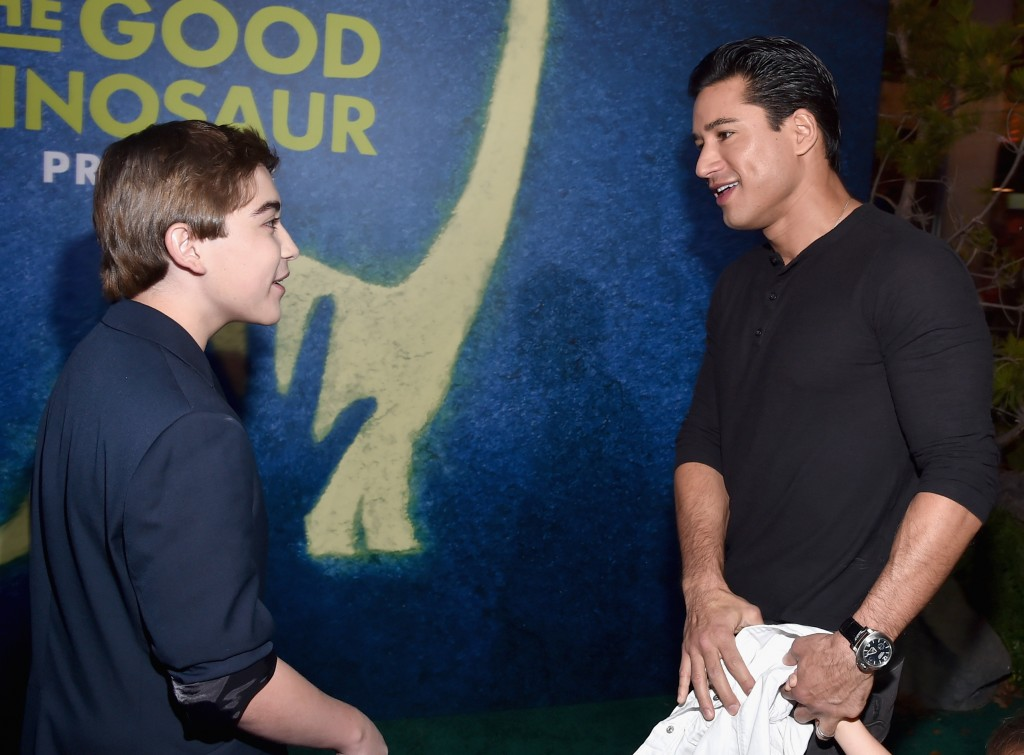 Actors Raymond Ochoa (L) and Mario Lopez attend the World Premiere Of Disney-Pixar's THE GOOD DINOSAUR at the El Capitan Theatre on November 17, 2015 in Hollywood, California. (Photo by Alberto E. Rodriguez/Getty Images for Disney)