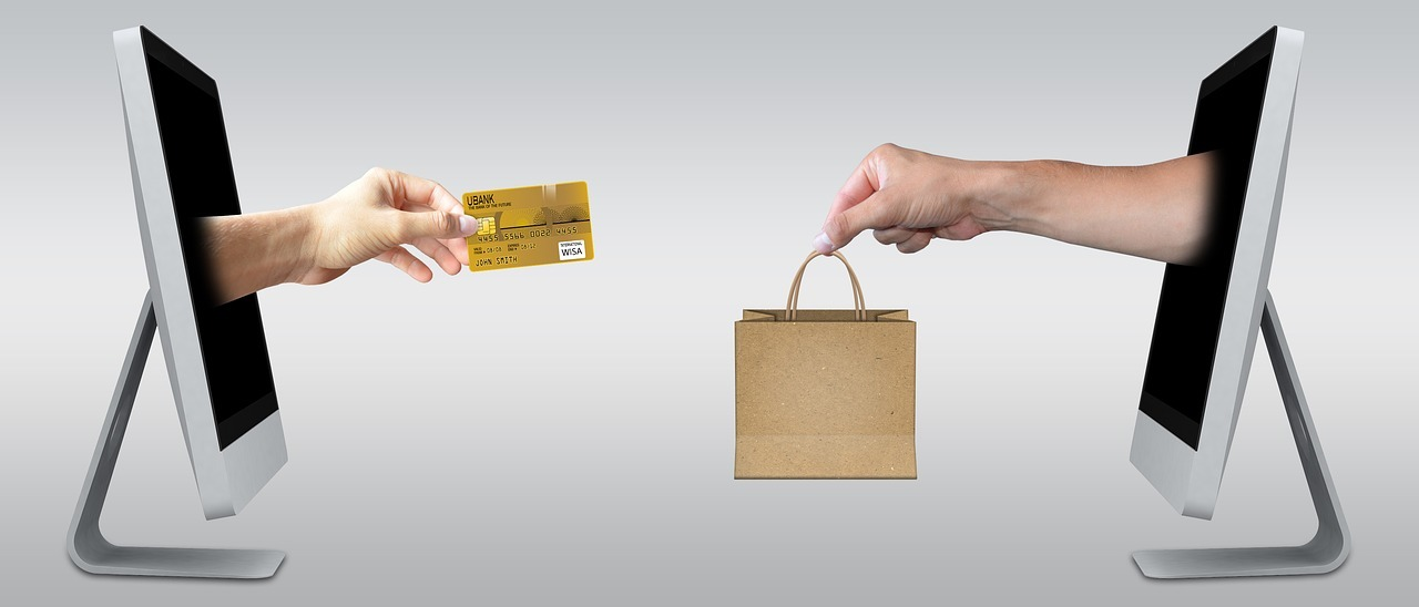 consumer and merchant exchanging goods and credit card through the internet