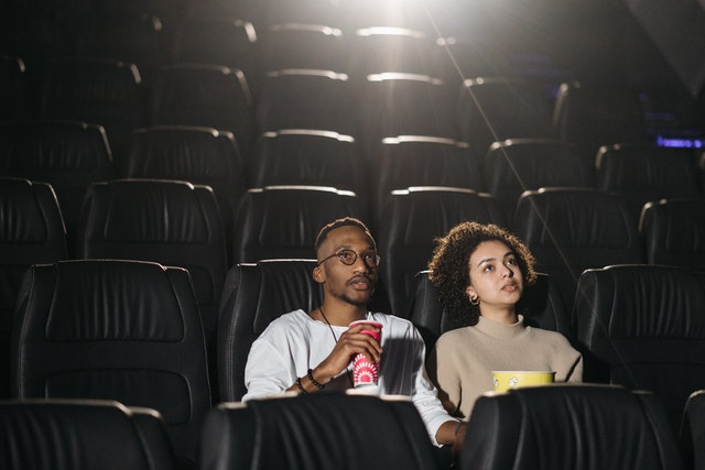 couples watching movie in cinema hall